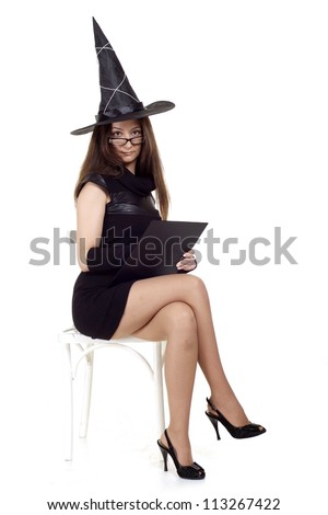 Beauteous girl as a witch on a white background - stock photo