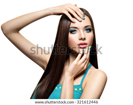 Beautfiul fashion woman with turquoise make-up and nails  - on white background - stock photo