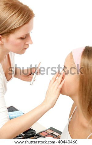 Beautician Applying Woman's Make Up