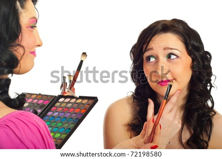 Beautician having conversation with model woman about what  make up color to  apply overher face isolated on white background
