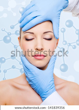 beautician touching attractive health woman face. beauty treatment of skin - stock photo