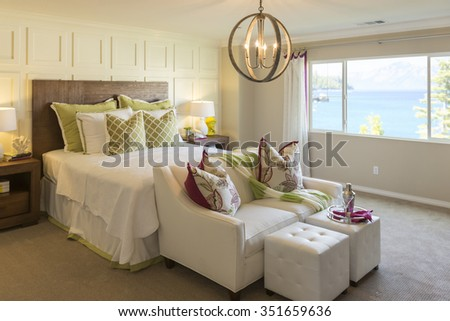 Beautiful Abstract of Inviting Bedroom Interior and Sitting Area. - stock photo