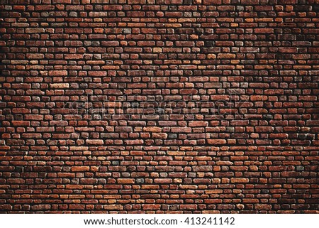 Beautiful accurate textured brick wall on a bright sunny day. Brick background - stock photo