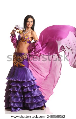 beautiful, active dancer in a lush, gorgeous dance costumes. dance movements, artistic emotions. the Arab Dance - stock photo