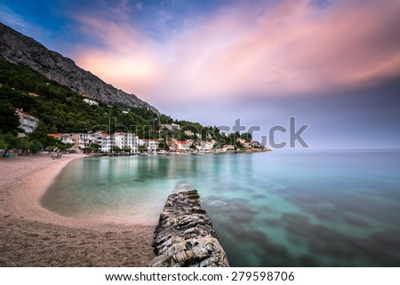 Beautiful Adriatic Beach and Mimice Village on Omis Riviera in Dalmatia, Croatia - stock photo