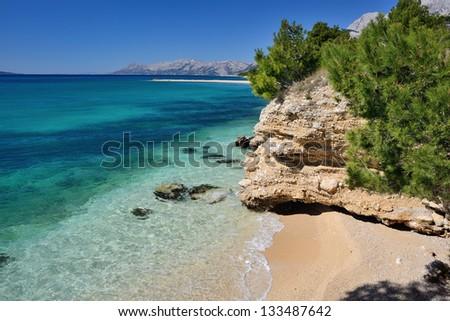 Beautiful Adriatic Sea bay with pines in Croatia - stock photo