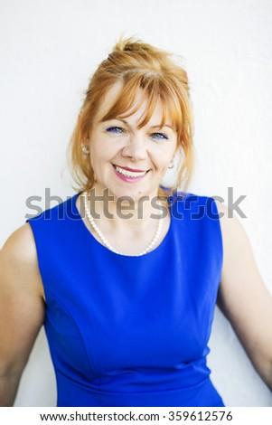 Beautiful adult female portrait on white background - stock photo