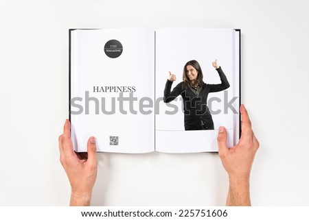 Beautiful adult girl doing an OK gesture printed on book - stock photo