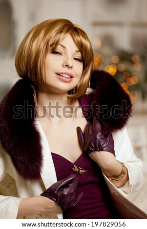 Beautiful adult woman in  winter coat with fur. Trendy modern blondy girl with short hair - stock photo