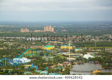 Beautiful aerial city view of Orlando taken from helicopter. Panoramic view of skyline with buildings, roads and parks. Green space. - stock photo