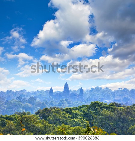 Beautiful aerial view of Angkor Wat Temple towers ascending from the jungles, Siem Reap, Cambodia