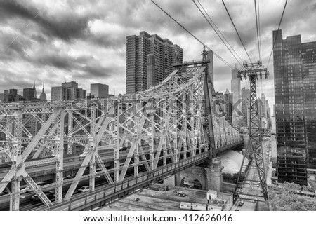 Beautiful aerial view of Queensboro Bridge connecting Manhattan and Roosevelt Island, New York City. - stock photo