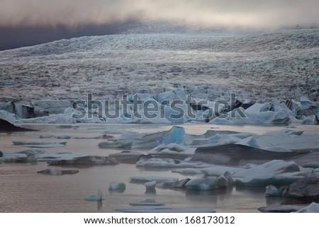 Beautiful aerial view on icelandic glacier and glacier lagoon - stock photo