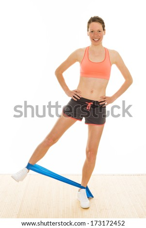 beautiful aerobic trainer is showing gymnastic exercises with a