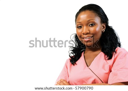 Beautiful African American female medical professional in scrubs - smiling - stock photo