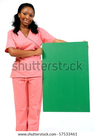 Beautiful African American medical professional - holding blank green posterboard to side - ready for text - stock photo