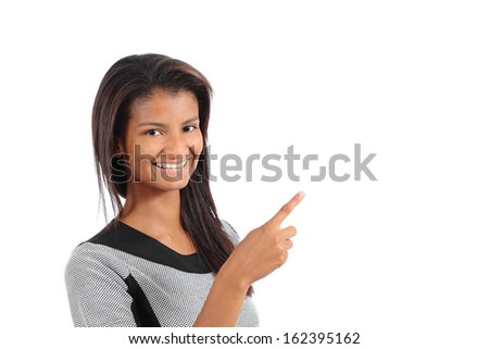 Beautiful african american model woman pointing and presenting beside isolated on a white background - stock photo