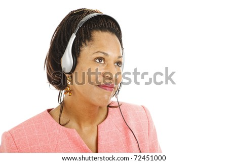 Beautiful african american phone service representative listening to a customer.  Isolated on white.