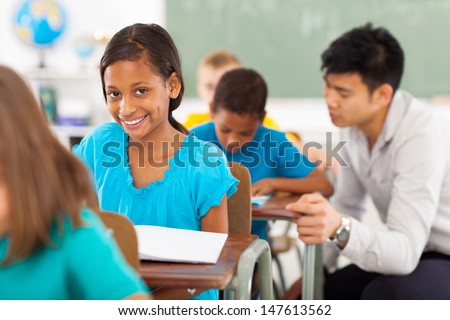 beautiful african american school girl in classroom  - stock photo