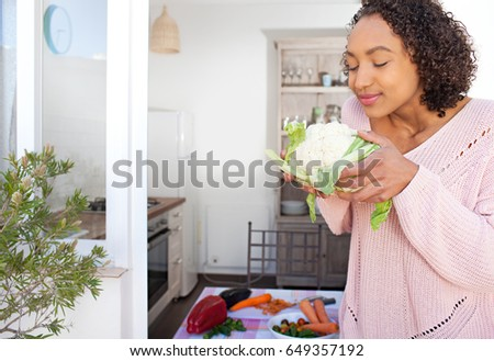 african-american-teen-girl-smelling
