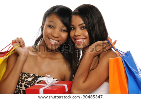 Beautiful African American Teens holding shopping bags smiling isolated on a white background - stock photo