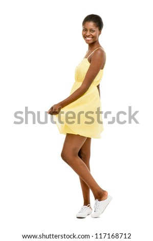 Beautiful African American Woman dancing yellow dress isolated on white background - stock photo