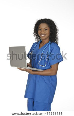 Beautiful African American woman doctor or nurse holding a laptop computer isolated on a white background