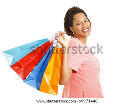 Beautiful African-american woman holding a handful of shopping bags.  Isolated on white.