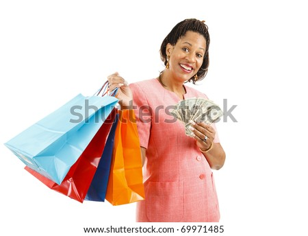 Beautiful African-american woman holding shopping bags and money.  Isolated on white.