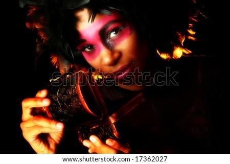 Beautiful african american woman in artistic cosmetics opening box. - stock photo