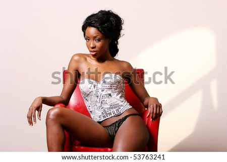 Beautiful african american woman in sexy lingerie - stock photo