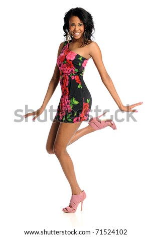 Beautiful African American woman jumping isolated over white background - stock photo