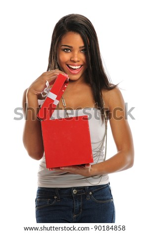 Beautiful African American woman opening red gift box isolated over white background - stock photo