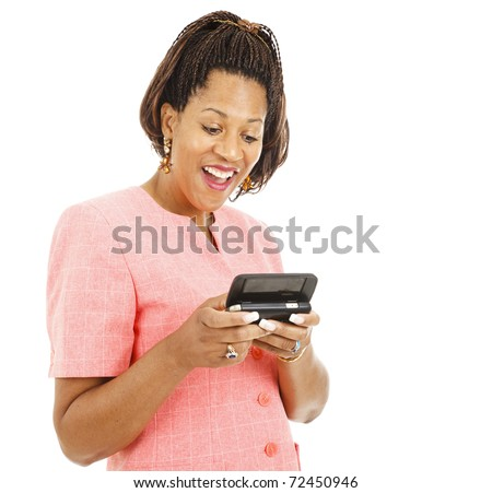 Beautiful african american woman reading an interesting text message.  Isolated on white. - stock photo