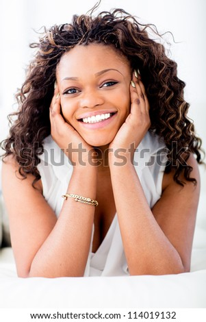 Beautiful African American woman smiling looking very happy