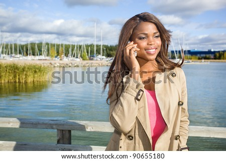 Beautiful african american woman talking on a phone