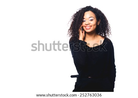 Beautiful African American woman talking on cell phone, isolated on white background - stock photo