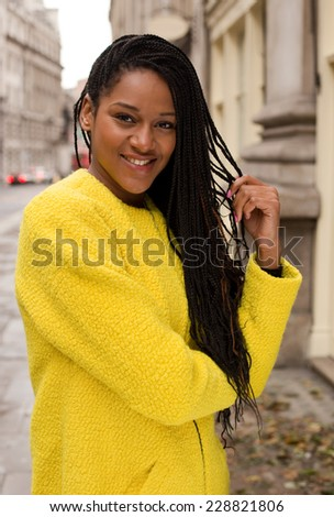 beautiful african american woman wearing a colourful yellow jumper. - stock photo