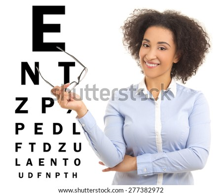 beautiful african american woman with glasses and eye test chart isolated on white background - stock photo