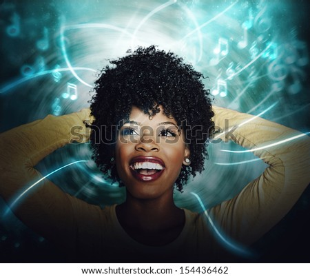 Beautiful African American Young woman listening to online streaming music - stock photo