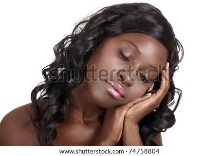 beautiful African American young woman with long curly hair with her eyes closed resting on hands - easy to extend background for copy space over white. - stock photo