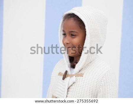 Beautiful african child with blue background outside - stock photo