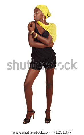 beautiful African model with fit slim body and long legs wearing shorts and yellow head scarf on white background - stock photo