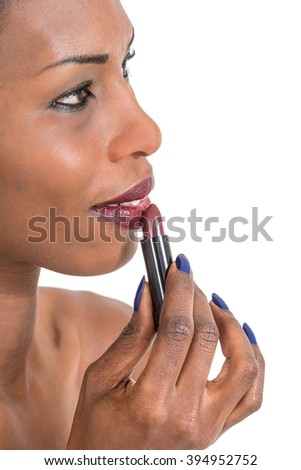 Beautiful  african woman applying red lipstick, closeup shot