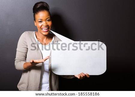beautiful african woman holding speech bubble - stock photo