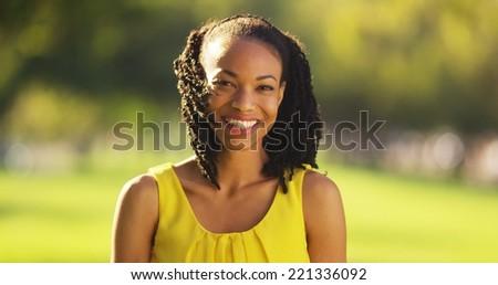 Beautiful African woman looking at camera - stock photo