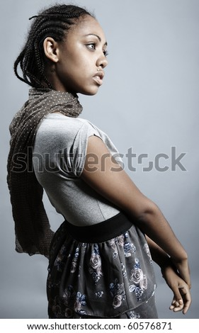 Beautiful African woman with natural make-up pose on grey background. - stock photo