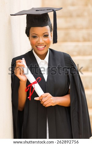 beautiful afro american graduate holding diploma - stock photo