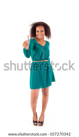 Beautiful afro  woman showing thumbs up - stock photo