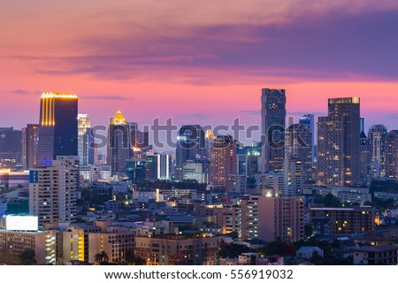 Beautiful after sunset sky over Bangkok office building business downtown, Thailand